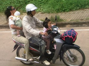 Family of Four on Motorbike in Thaialnd